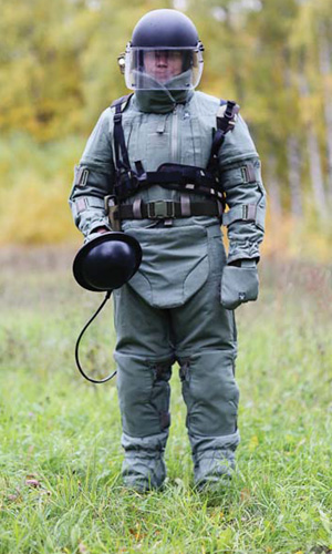 "A bomb technician in the ""Sokol"" protective set with a portable non-contact explosive device finder INVU-3M"